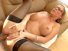 Sexy milf in stockings and glasses fucked