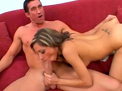 A hot chick sucks on a super thick cock
