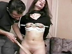 Hardcore brunette is getting pins over her pussy