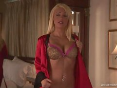 Krystal Lyne the gorgeous blonde lies on the bed and plays with her boobs