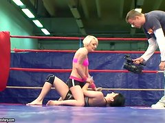Lucy Bell and Paige Fox lick each other's pussies on a ring