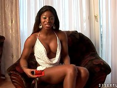 Ebony porn star Jasmine gives an interview in the living room