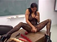 Cute pigtailed girl masturbates for audience in class