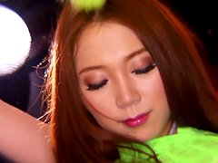 Asami Ogawa Sucking Two Cocks in Flamboyant Floursescent Green Outfit