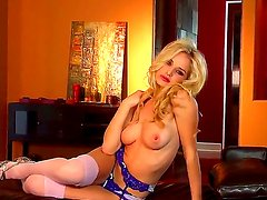Burning hot glam blonde Liz strips and teases us with her sexy figure and trimmed pussy