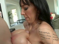 Huge titted milf getting tit fucked after sucking on cock