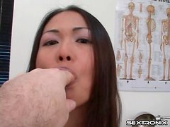 Asian in doctor office bares little tits