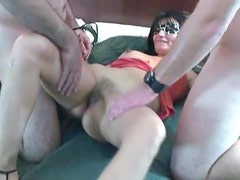 Horny swinger milf blows two guys