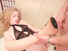 Flawless blonde beauty in lingerie loves a footjob