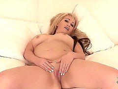 Busty blonde Roxette Rocks enjoys having her clit and pussy deep penetrated