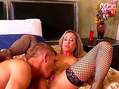 Gorgeous big tited milf Brandi Love takes off her bra and sucks Bill Baileys big dick