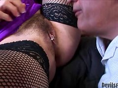 Mature babe in fishnets gets fucked in her bushy pussy