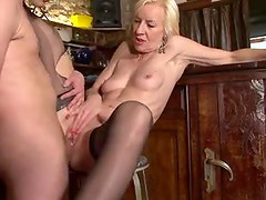 Sexy mature blonde in stockings has anal sex
