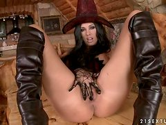 The Black Witch Sandy makes some magic to her pussy