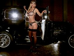 Blonde hottie Carlye Denise poses for the cam near a car