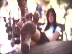 Chick stomping in dirty for foot fetish fans