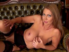 Busty milf Leigh Darby is posing on the couch