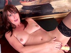 Redhead mature Lily loves that nasty vibrator