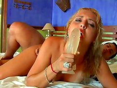 Busty blonde Pryscila Brandao is sucking Tony Tigrao's wiener