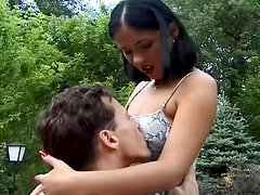 Anita Black gets her holes drilled on a table outdoors