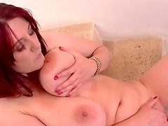 Redhead babe with big boobies is showing hr pretty boobies
