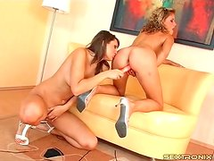Curly hair blonde hottie puts toy in girl pussy