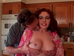 He fondles the hot redheaded milf in a robe