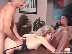Beautiful girls star in retro threesome