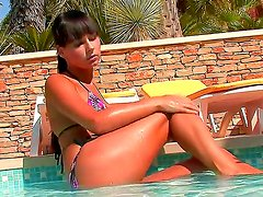 Mesmerizing teenager Carie with gorgeous plump and round boobs posing in the pool