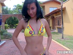 Cute black haired chica Angie in yellow bikini shows off