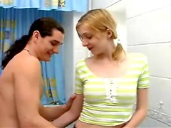 Kissing a cute teenager in the bathroom
