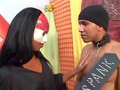 Mistress with spanking paddle teases him
