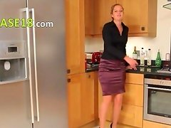 Blonde woman in kitchen teasing hard