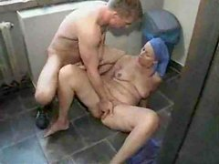 Mature cleaner gets fucked on the floor in the restroom