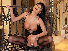 Brunette Roxanne Milana is playing with her cute tits
