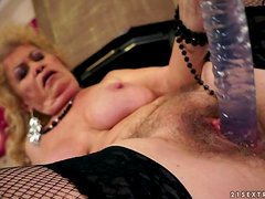 Effie moans in pleasure while fingering and toying her old hairy snatch