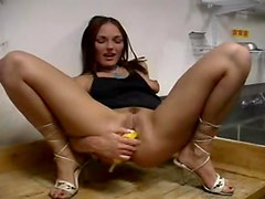 Banana fucking brunette girl in the kitchen