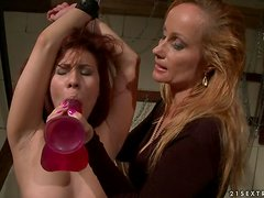Katy loves squeezing Patricia's nipples and clipping her pussy