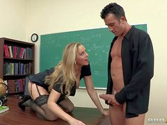 Blonde and heavy chested teacher Julia Ann in provocative stockings