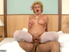 Blonde granny Effie does all that she can to make this guy cum