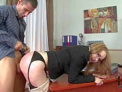Four-eyed elegant secretary bends over for her boss. She gets