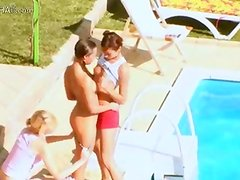 Three chicks secret sexing by the pool