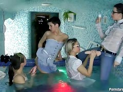 Clothed lesbian dildo play in hot tub