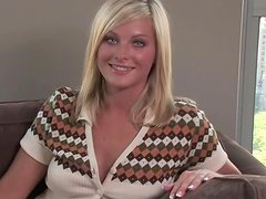 Aryka Lynne gives an interview sitting on the sofa