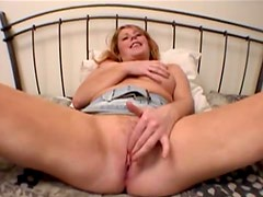 Milf redhead with sexy naturals rubs pussy