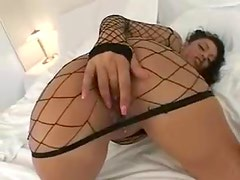 Latina teases in her sexy fishnet dress