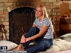 Blonde porn star Sandy gives an interview in the living room