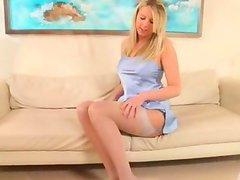 Blonde teenager on white leather couch