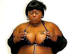 Big, black, and Bigtitted honey Thunder Cat introduces herself and answers some questions while dressed in A  outfit. She has undressed till she's joined by A  Sexy chocolate man, and she goes we