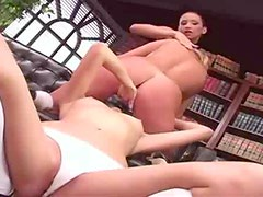 The headmistress and students eat pussy